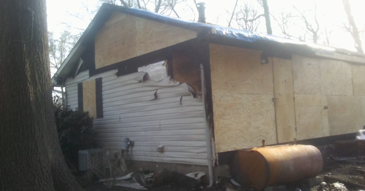 Boarded up home by Modern Remodeling Maryland after house fire