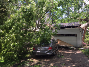 Tree on roof repaired by Modern Remodeling