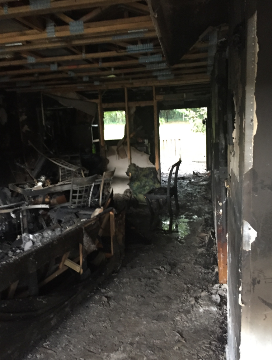 Burned living room after house fire