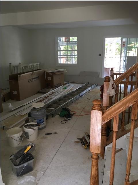 Fire damaged living room rebuild by Modern Remodeling