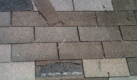 Photo of Damage to Shingles caused by wind