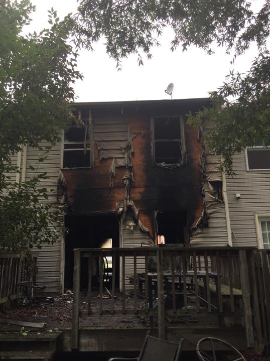 Fire damaged rear of town home Modern rebuilt